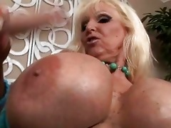 tanned blond with massive boobs sucking younger