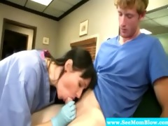 aged brunette hair nurse sucking on cock