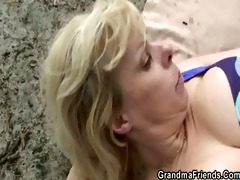 granny rides and sucks at same time outdoors