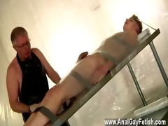gay fuck strapped down and at the grace of his