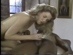 youthful blonde white woman with older black man