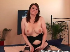 breasty aged woman unloads a cock in her face