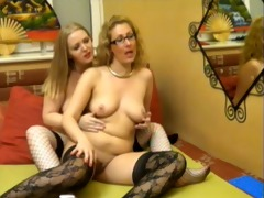 2 ladies rubbing and fingering