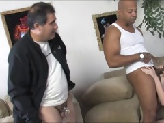 young wife feeds old cuckold with a spoon of
