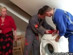 two repairmen bang breasty grandma from both ends
