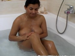 youthful chap watches mature in the tub