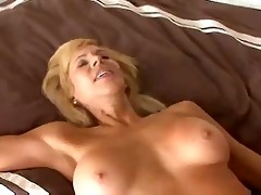 busty mature cougar seduces a younger boy