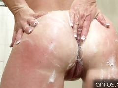 her own cum dripping from her older pussy